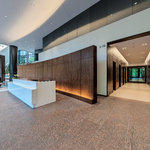 3 Ravinia Virtual Tour: Main Lobby – Security Desk & Elevator Banks